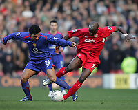Photo: Lee Earle.<br /> Liverpool v Manchester United. The FA Cup. 18/02/2006. United's Kieran Richardson (L) battles with Momo Sissoko.