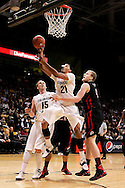 February 21st, 2013 Boulder, CO - Colorado Buffaloes junior forward André Roberson (21) lays up a shot against the Utes defense during the NCAA basketball game between the University of Utah Utes and the University of Colorado Buffaloes at the Coors Events Center in Boulder CO