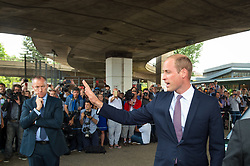 The Duke of Cambridge responds to a member of the public in the crowd as he leaves following a visit to the Westway Sports Centre, London, which is providing temporary shelter for those who have been made homeless in the Grenfell Tower disaster.