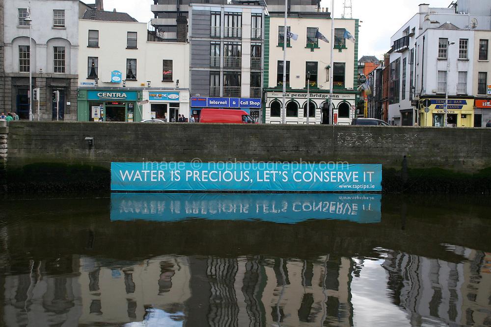 Environmental message on River Liffey Dublin Ireland