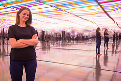 © Licensed to London News Pictures. 16/07/2015. Bradford, UK. Picture shows Artist Liz West. A new light-art exhibition called An Additive Mix created by artist Liz West has been opened in the Bradford Media Museum. The piece comprises of a 10m x 5m room containing hundreds of coloured fluorescent lights combined with infinity mirrors creating a unique immersive experience. Photo credit : Andrew McCaren/LNP