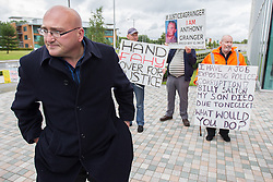 © Licensed to London News Pictures . 13/08/2014 .  Manchester , UK . DOMENYK NOONAN at the demonstration . Several campaign groups - including those campaigning over the death of Anthony Grainger as well as gangster Domenyk Noonan and those involved with the Barton Moss anti-fracking campaign - protest outside Greater Manchester Police Headquarters this afternoon ( Wednesday 13th August 2014 ) as GMP chief Sir Peter Fahy is being investigated by the IPCC over several allegations , including that a 14 year old boy was allowed to enter the home of a suspected paedophile whilst the home was under surveillance by GMP and also over the disposal of body parts in relation to the case of former Hyde GP , Harold Shipman . Photo credit : Joel Goodman/LNP