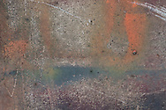 Rust and paint on a wall in Kumasi, Ghana, as part of the Kumasi Colors series.