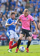 Portsmouth defender Kieron Freeman and Northampton Town Midfielder Nicky Adams during the Sky Bet League 2 match between Portsmouth and Northampton Town at Fratton Park, Portsmouth, England on 7 May 2016. Photo by Adam Rivers.