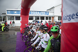 Riders find refuge from the torrential rain under the start gate before Stage 3 of the Ladies Tour of Norway - a 156.6 km road race, between Svinesund (SE) and Halden on August 20, 2017, in Ostfold, Norway. (Photo by Balint Hamvas/Velofocus.com)
