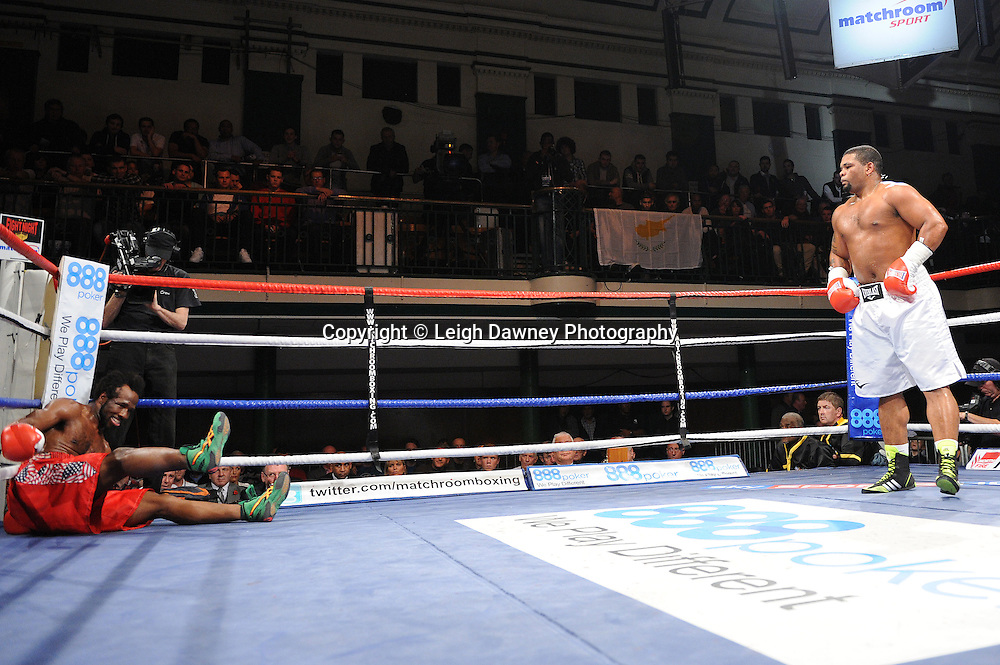 Mike Perez (white shorts) knocks down Zack Page in 8x3min Heavyweight contest at York Hall 09.11.11. Matchroom Sport. Photo credit: © Leigh Dawney 2011.