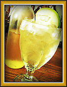 Lime Margarita with bottle on bar cellphone photography,Iphone pictures,smartphone pictures