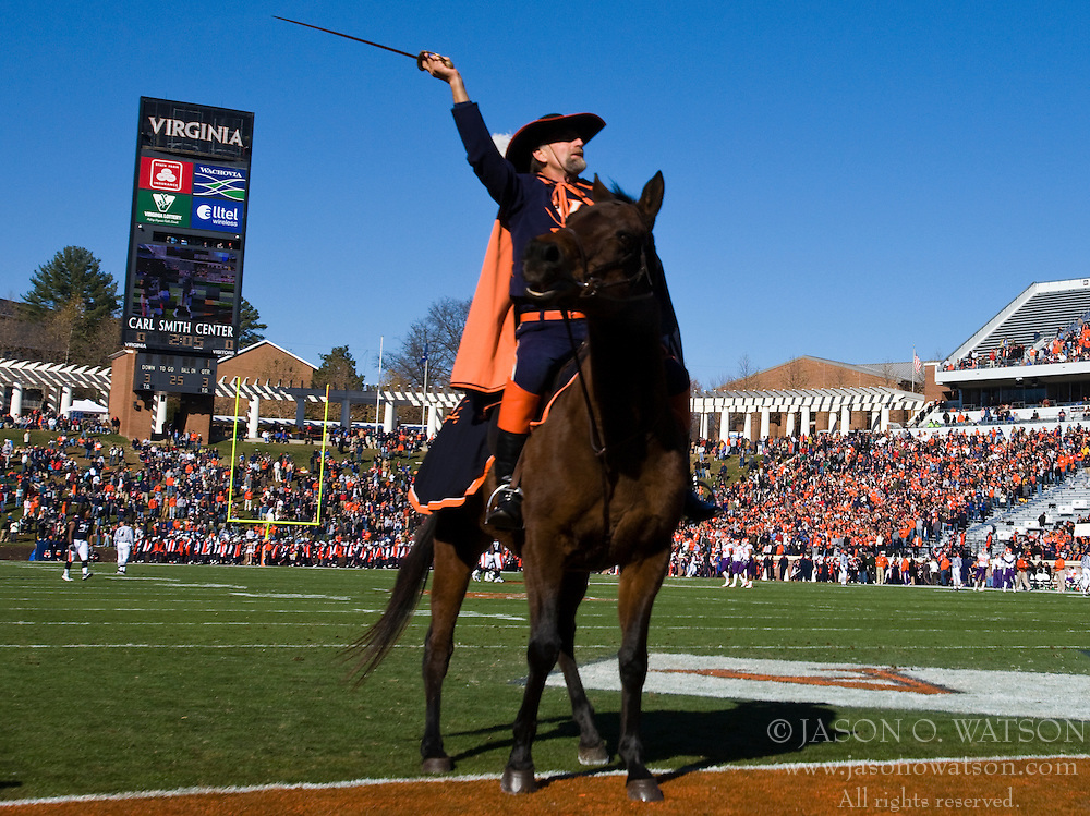 The Virginia Cavaliers mascot and his horse Sabre ride out on the field for the start of a football game.  The Clemson Tigers defeated the Virginia Cavaliers 13-3 in NCAA Division 1 football at Scott Stadium on the Grounds of the University of Virginia in Charlottesville, VA on November 22, 2008.
