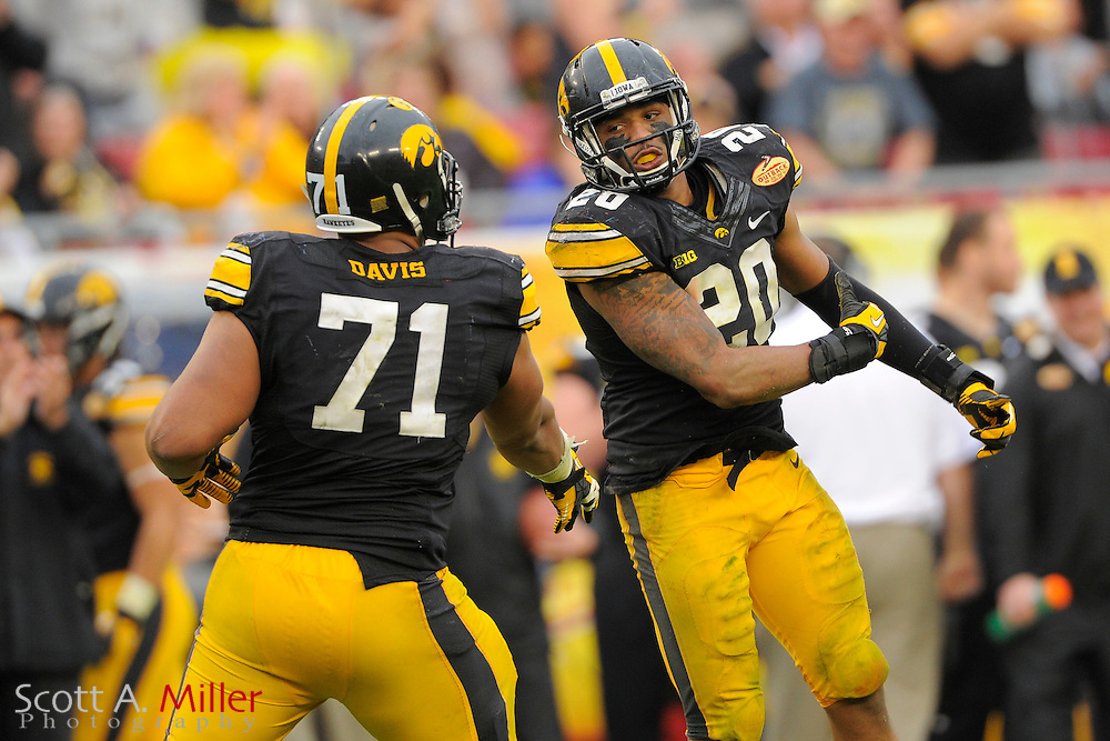 Iowa Hawkeyes linebacker Christian Kirksey (20) celebrates during LSU's 21-14 win over the Hawkeyes in the 2014 Outback Bowl at Raymond James Stadium on Jan 1, 2014  in Tampa, Florida.            ©2014 Scott A. Miller
