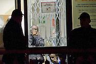 Roma, 13 Nov 2014<br /> Terzo giorno di tensioni tra italiani ed immigrati ospiti nel centro di accoglienza per rifugiati nel quartiere di Tor Sapienza. I migranti  chiusi dentro al centro di accoglienza protetti dalla polizia.<br /> Rome, Italy. 13th November 2014<br /> Third day of tensions between Italian  and immigrants guests in the migrant reception center in the neighborhood of Tor Sapienza. The migrants locked in at the reception center protected by the police.