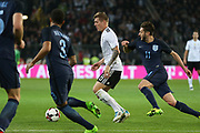 Toni Kroos of Germany battles with Adam Lallana of England during the International Friendly match between Germany and England at Signal Iduna Park, Dortmund, Germany on 22 March 2017. Photo by Phil Duncan.