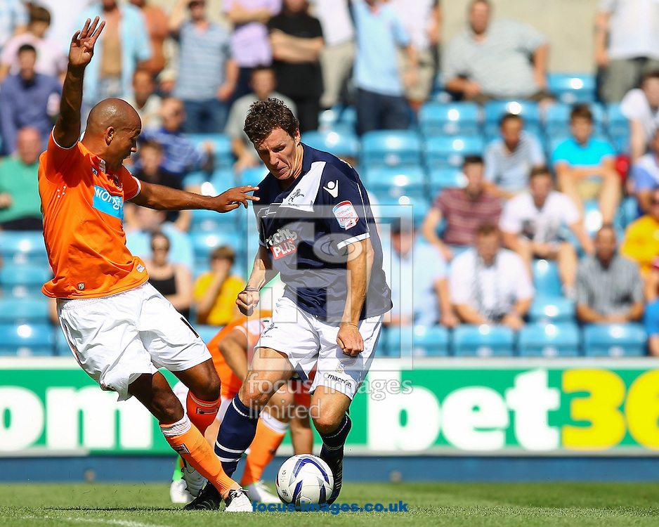 Picture by John  Rainford/Focus Images Ltd +44 7506 538356.18/08/2012.Darius Henderson of Millwall and Isaiah Osbourne of  Blackpool during the npower Championship match at The Den, London.