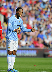 Manchester City's Joleon Lescott cuts a frustrated figure  - Photo mandatory by-line: Joe Meredith/JMP - Tel: Mobile: 07966 386802 25/08/2013 - SPORT - FOOTBALL - Cardiff City Stadium - Cardiff -  Cardiff City V Manchester City - Barclays Premier League