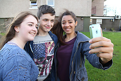 Teenagers taking selfie with mobile phone