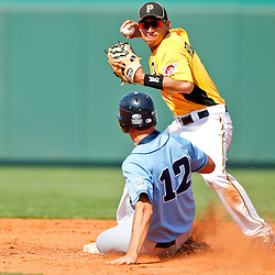 February 25, 2011; Bradenton, FL, USA; Pittsburgh Pirates shortstop Josh Rodriguez (7) forces out State College of Florida Manatees  Steven Leasure (12) during a spring training exhibition game against the at McKechnie Field. The Pirates defeated the Manatees 21-1. Mandatory Credit: Derick E. Hingle-US PRESSWIRE