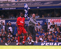A disgruntled Everton fan throws his flag at Liverpool's Salid Diao after invading the pitch shortly after the 2nd Liverpool goal. Everton v Liverpool, FA Premiership, 19/04/2003. Credit: Colorsport / Matthew Impey