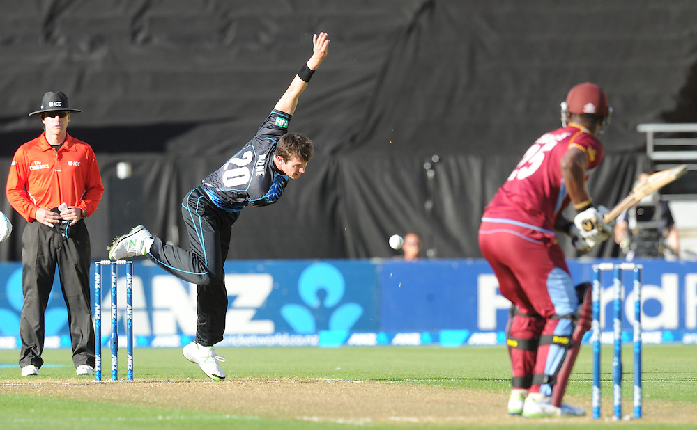 New Zealand's Adam Milne, left, bowls to West Indies Johnson Charles in the second T20 International cricket match, Westpac Stadium, Wellington, New Zealand, Wednesday, January 15, 2014. Credit:SNPA / Ross Setford