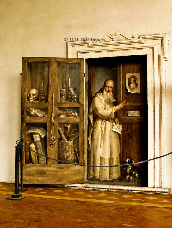 Museo Nazionale de Roma, Terme Diocletiani, trompe d'oiel painting of a monk with a little dog coming through a door in the cloister of the Carthusian monastery adjoining the baths of Diocletian.    This fresco is probably later, 17th century.  A guard rope is secured in front of it.