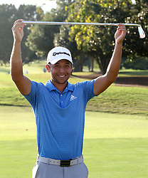 September 24, 2017 - Atlanta, Georgia, United States - Xander Schauffele holds the Calamity Jane trophy on the 18th green after winning the TOUR Championship at the East Lake Club. (Credit Image: © Debby Wong via ZUMA Wire)