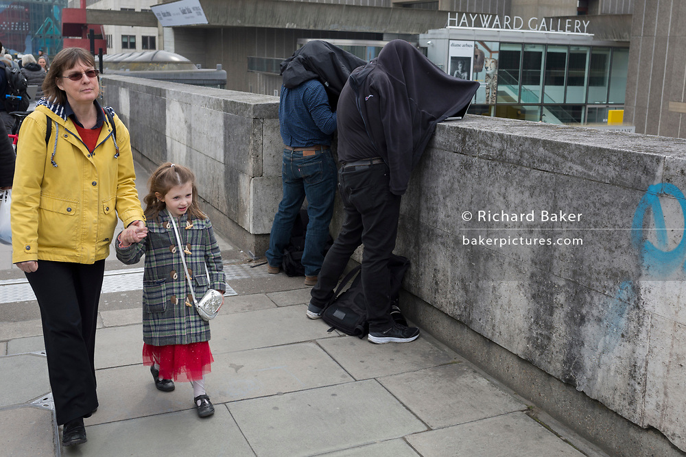 Press photographers work under dark conditions while activists with Extinction Rebellion campaign for a better future for planet Earth after blocking Waterloo Bridge and as part of a multi-location 5-day Easter protest around the capital, on 16th April 2019, in London, England.