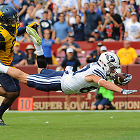 24 September 2016:   Brigham Young Cougars wide receiver Mitchell Juergens (87) dives for a touchdown after a pass reception against West Virginia Mountaineers safety Jeremy Tyler (2) at FedEx Field, in Landover, MD. (Photograph by Mark Goldman/Icon Sportswire)