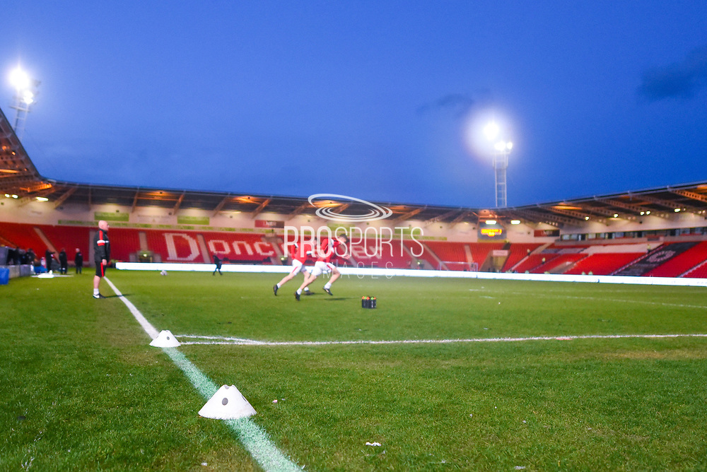A general view of Keepmoat Stadium, as two players warm up, before the EFL Sky Bet League 1 match between Doncaster Rovers and Barnsley at the Keepmoat Stadium, Doncaster, England on 15 March 2019.