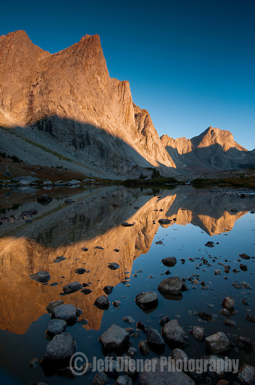 Towering peaks glow at sunrise in the Wind River Mountains, Wyoming.