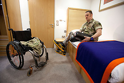 © Licensed to London News Pictures. 22/11/2012. Shropshire, UK. Sapper Clive Smith, who lost his legs on operations in Afghanistan in 2010, puts on his prosthetic legs in a room at the newly opened Battle Back Centre (Lilleshall) in Shropshire today (22/11/12). The centre, set up by services charity the Royal British Legion in partnership with the Ministry of Defence to provide, can handle up to 600 wounded, injured or sick military personnel a year as part of their rehabilitation. Photo credit: Matt Cetti-Roberts/LNP