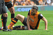 Hull City midfielder Robert Snodgrass (10) in pain after impact with Rotherham United defender Richard Wood (6) in the penalty araea  during the Sky Bet Championship match between Hull City and Rotherham United at the KC Stadium, Kingston upon Hull, England on 7 May 2016. Photo by Ian Lyall.