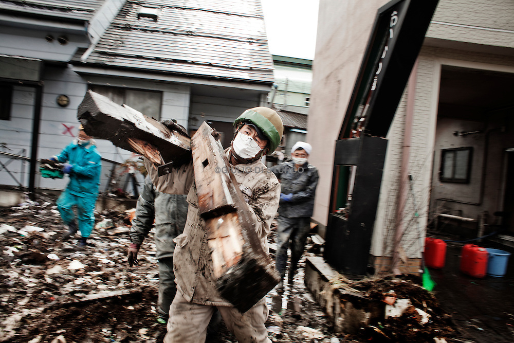 Volunteers came from all over Japan to help and clean up  houses damaged by the tsunami on March 27, 2011..Kamaishi use to be famous for  its steel production and most recently for its promotion of eco-tourism.