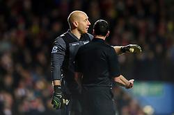 Aston Villa Goalkeeper Brad Guzan (USA) looks exhaspirated as he talks to referee Neil Swarbrick during the second half of the match - Photo mandatory by-line: Rogan Thomson/JMP - Tel: Mobile: 07966 386802 - 13/01/2014 - SPORT - FOOTBALL - Villa Park, Birmingham - Aston Villa v Arsenal  - Barclays Premier League.