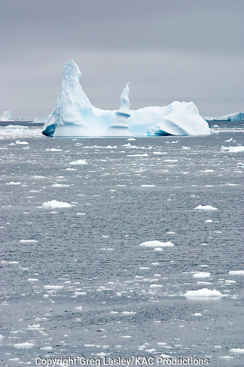 Unusual iceberg.Lemaire Channel, Antarctica.cloudy and dark day.30 January 2003