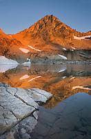 Black Peak reflected in Wing Lake at sunrise, North Cascades Washington