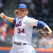 Pitcher Noah Syndergaard, New York Mets, pitching during the New York Mets Vs Philadelphia Phillies MLB regular season baseball game at Citi Field, Queens, New York. USA. 27th May 2015. Photo Tim Clayton