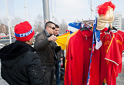 Supporters of Macedonia buying T-shirts prior to the handball match between Slovenia and F.Y.R. Macedonia for 5th place at 10th EHF European Handball Championship Serbia 2012, on January 27, 2012 in Beogradska Arena, Belgrade, Serbia.  (Photo By Vid Ponikvar / Sportida.com)