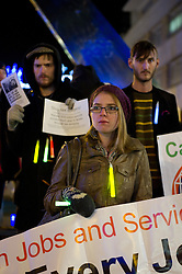 © under license to London News Pictures.  16/12/2010 A girl with glow sticks listens to points from a speaker this evening in central Plymouth (16/12/2010) in a demonstration against public sector cuts. Picture credit should read: David Hedges/LNP