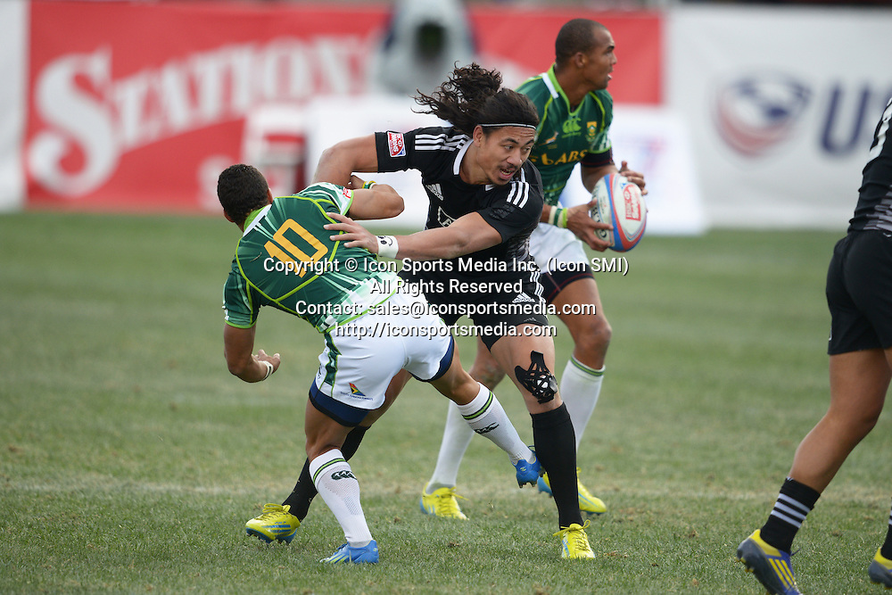 10 February 2013: Ben Lam (12) of New Zealand ended up in the sin bin after taking on Cheslin Kolbe (10) of South Africa in the Cup final of round 5 of the HSBC Sevens World Series of Rugby at Sam Boyd Stadium in Las Vegas, Nevada. South Africa defeated New Zealand 40-21.