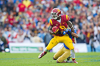 17 October 2012: Wide receiver (9) Marqise Lee of the USC Trojans catches a pass and is tackled against the UCLA Bruins during the second half of UCLA's 38-28 victory over USC at the Rose Bowl in Pasadena, CA.