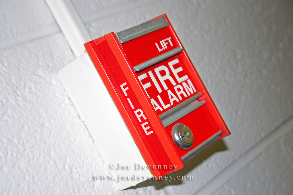 Red Fire Alarm box on a white wall