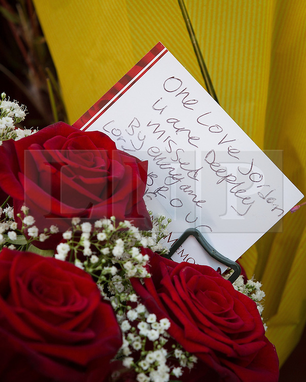 © Licensed to London News Pictures . 12/07/2013 . Manchester , UK . Flowers and tributes at the scene on 5 Beard Road , Gorton , Manchester , for Jordan Begley , who died on Wednesday evening (10th July 2013) after a taser was used on him by police . Police reported the incident , which has been referred to the IPCC , occurred at 20:15 after they responded to a disturbance involving a man with a knife . Photo credit : Joel Goodman/LNP