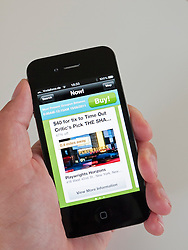 Using Groupon app to search for deals on shows in New York City on iPhone 4G smart phone
