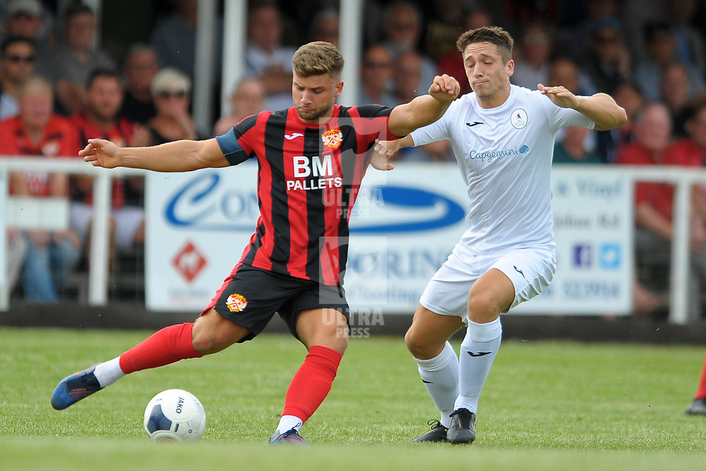 TELFORD COPYRIGHT MIKE SHERIDAN Michael Richens of Kettering battles with Adam Walker of Telford during the National League North fixture between Kettering Town and AFC Telford United at Latimer Park on Saturday, August 3, 2019<br /> <br /> Picture credit: Mike Sheridan<br /> <br /> MS201920-005