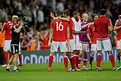 TOULOUSE, FRANCE - Monday, June 20, 2016: Wales masseur Chris Senior take a photograph of Joe Ledley and Ben Davies after the 3-0 victory over Russia and reaching the knock-out stage during the final Group B UEFA Euro 2016 Championship match at Stadium de Toulouse. (Pic by David Rawcliffe/Propaganda)
