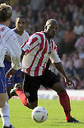 Nationwide Div 2 - Brentford v Hartlepool..Brentfords, Tony Rougier [right] moves the ball past  Hartlepool's No.8 Ritchie Humphreys © Peter Spurrier/Intersport-Images, email images@intersport-images.com. Mob +447973819551
