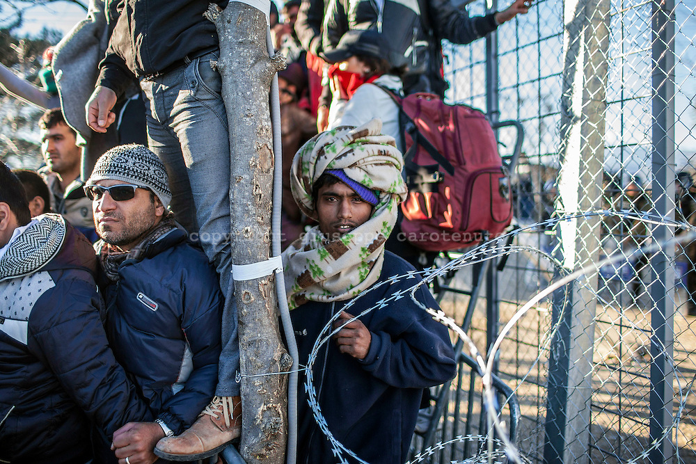 03 December 2015, Greece, Idomeni - Migrants and refugees wait to cross the Greek-Macedonian border near the village of Idomeni, Greece.