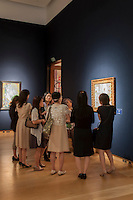 Japanese visitors at Christie's King street exhibition before the Impressionnists sale on June 24th 2014.