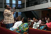Rev. Ferguson, of the Music Ministry, and co-founder of the Hip Hop Church NY, is preaching to those attending the Mass Service at the Hip Hop Church in Harlem, New York, NY., on Thursday, June 22, 2006. A new growing phenomenon in the United States, and in particular in its most multiethnic city, New York, the Hip Hop Church is the meeting point between Hip Hop and Christianity, a place where ëGodí is worshipped not according to religious dogmatisms and rules, but where the ëHoly Spirití is celebrated by the community through young, unique, passionate Hip Hop lyrics. Its mission is to present the Christian Gospel in a setting that appeals to both, those individuals who are confessed Christians, as well as those who are not regularly attending traditional Services, while helping many youngsters from underprivileged neighbourhoods to feel part of a community, to make them feel loved and to help them not to give up when problems arise. The Hip Hop Church is not only forward-thinking but it also has an important impact where life at times can be difficult and deceiving, and where young people can be easily influenced for the worst purposes. At the Hip Hop Church, members are encouraged to sing, dance and express themselves in any way that the ëSpirit of Godí moves them. Honours to students who have overcome adversity, community leaders, church leaders and some of the unsung pioneers of Hip Hop are common at this Church. Here, Hip Hop is the culture, while Jesus is the centre. Services are being mainly in Harlem, where many African Americans live; although the Hip Hop Church is not exclusive and people from any ethnic group are happily accepted and involved with as much enthusiasm. Rev. Ferguson, one of its pioneer founders, has developed ëHip-Hop Homileticsí, a preaching and worship technique designed to reach the children in their language and highlight their sensibilities, while bringing forth Christianity. This ëKeep It Realí evangelism style is the centrepiece of R