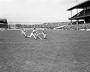 03/05/1970<br /> 05/03/1970<br /> 3 May 1970<br /> National Hurling League Final: Limerick v Cork at Croke Park, Dublin. <br /> W. Walsh (Cork) beats J. Doom (Limerick) in a midfield race for the ball.