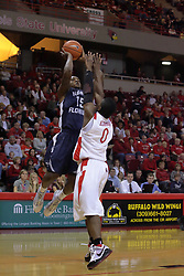 21 November 2009: Using a fading jumper, Jerron Granberry shoots over Osiris Eldridge. The Ospreys of North Florida fall to the Redbirds of Illinois State 71-55 on Doug Collins Court inside Redbird Arena in Normal Illinois.