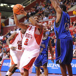 Feb 8, 2009; Piscataway, NJ, USA; Rutgers guard Anthony Farmer (2) takes a shot against Seton Hall forward Mike Davis (13) during the first half of Seton Hall's 65-60 victory at the Louis Brown Athletic Center.